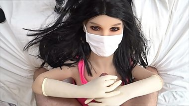Doll nurse gives handjob with surgical gloves