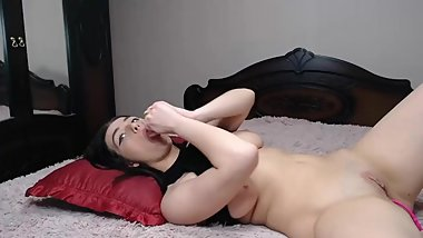 beautiful woman with double dildo penetrating and masturbating in bed