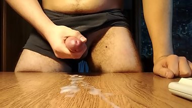 Jerking off my big dick and cumming abundantly on the table