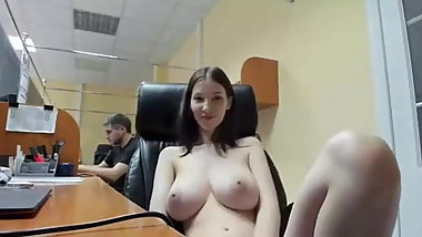 young naked woman in an office next to her colleague