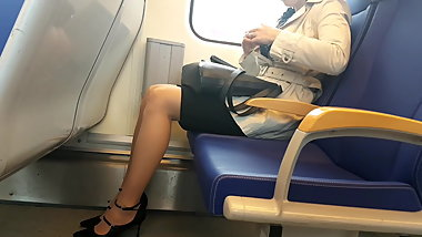 Young woman wearing nude pantyhose in train
